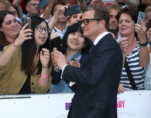 Colin Firth poses for photographs with fans