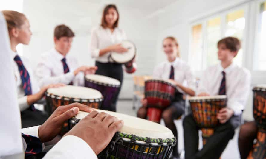 Teenage students studying percussion in a music class