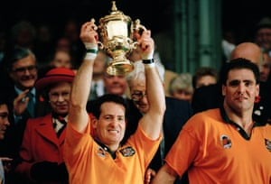 David Campese of Australia holds the Webb Ellis Cup aloft after their 12-9 victory over England in the Rugby World Cup final held at Twickenham in 1991.