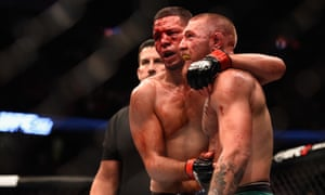 Nate Diaz shakes hands with Conor McGregor after their epic fight