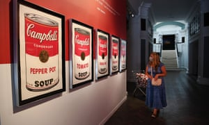A visitor to the Andy Warhol exhibition at the Halcyon Gallery in London