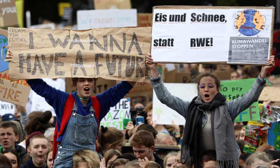 Students hold placards as they take part in a global climate strike in Berlin