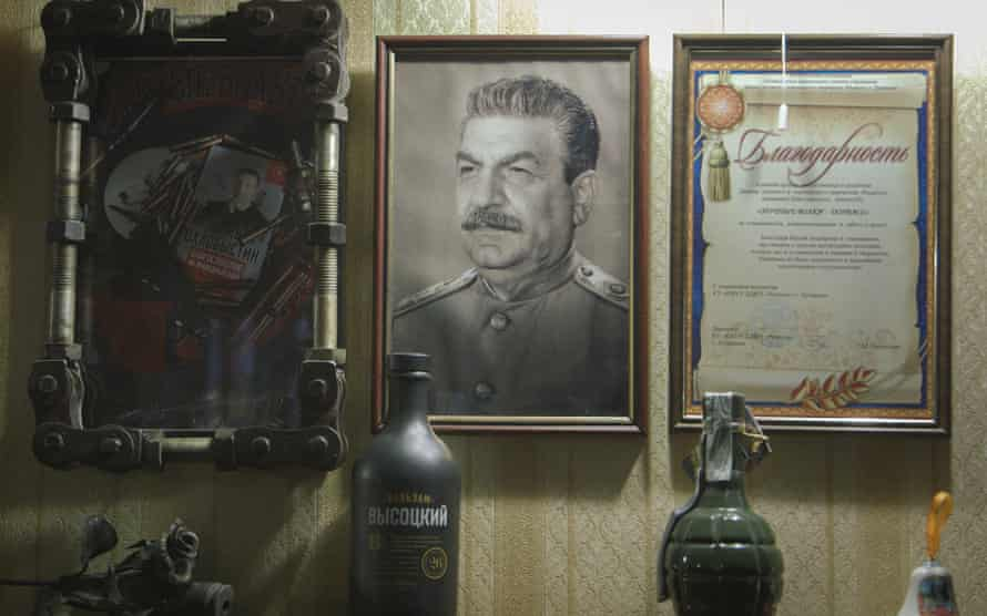 At the Luhansk base of the Night Wolves Russian biker gang, a portrait of Stalin shares a wall with a grenade