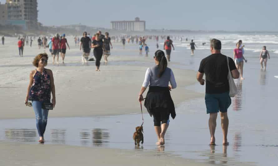 People walk on the beach during the coronavirus pandemic on Friday.