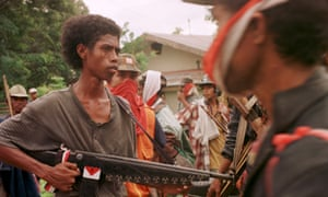 Members of the anti-independence East Timorese militia Besi Mera Putih (Iron Red and White) before attacking pro-independence supporters in the town of Liquica, East Timor