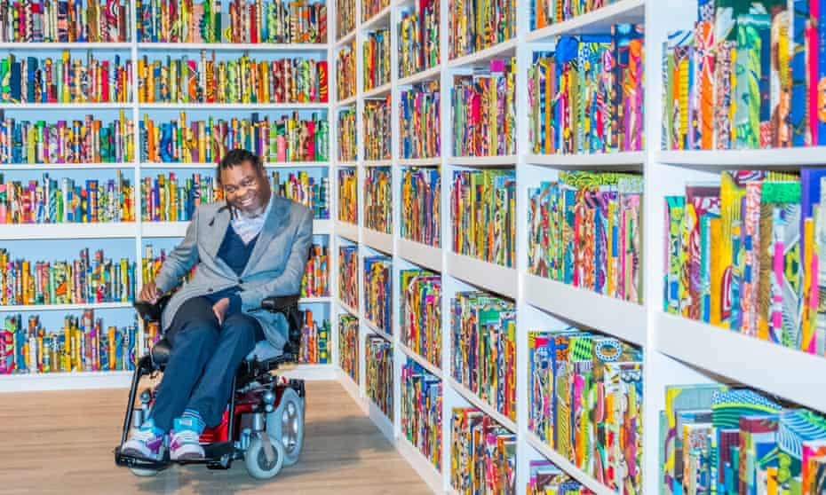 Yinka Shonibare with his installation The British Library in Tate Modern, south-east London
