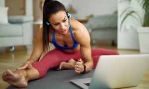 A female personal trainer doing exercises