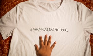 A hand on a charity Spice Girls T-shirt