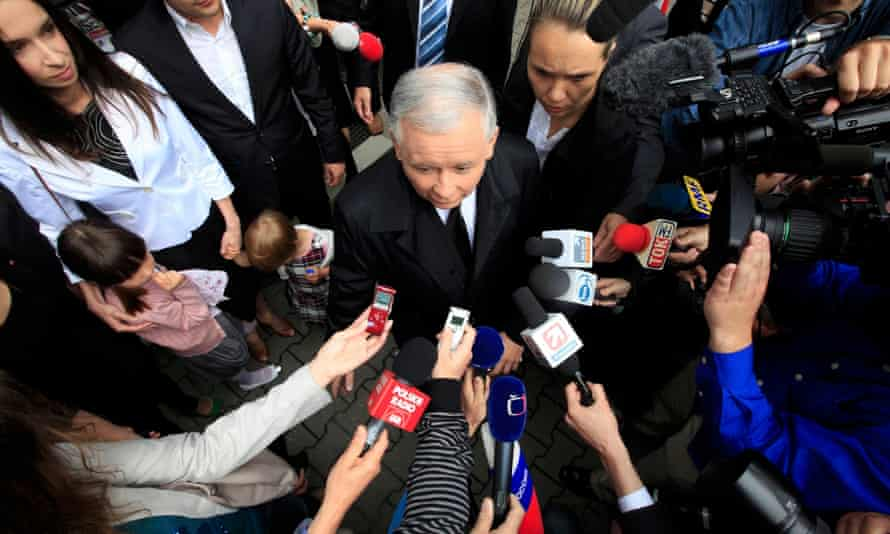 Jarosław Kaczyński, presidential candidate of Poland's Law and Justice Party is surrounded by media as he leaves a polling station in Warsaw.