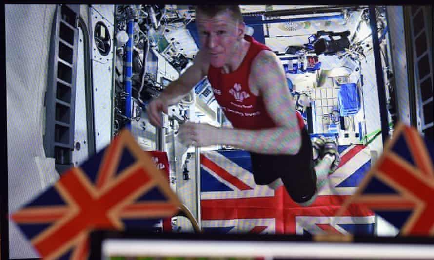 British astronaut Tim Peake celebrates after completing his marathon aboard the international space station.