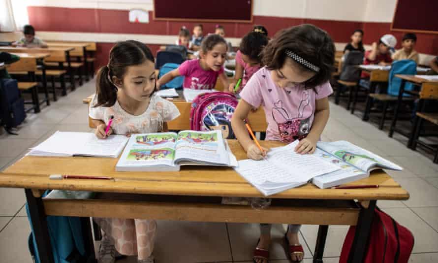 Syrian refugee children attend school at a camp in Turkey.