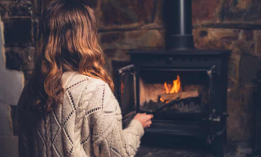 Woman in front of fire