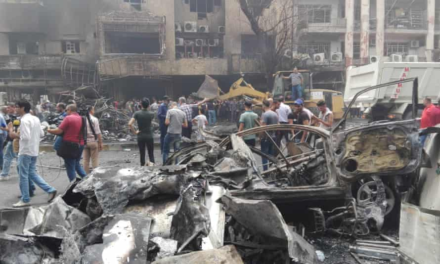 Photo taken on July 3, 2016 shows the car bomb attack site in Karrada-Dakhil district of southern Baghdad, Iraq. The Islamic State group claimed responsibility for the attack