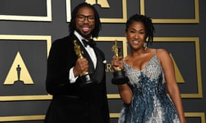Matthew A Cherry and producer Karen Rupert Toliver with their trophies