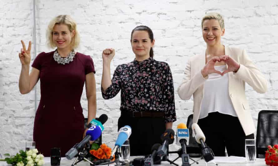 Veronika Tsepkalo (left), Svetlana Tikhanovskaya (centre), and Maria Kolesnikova display their signature gestures at a press-conference in Minsk in July.