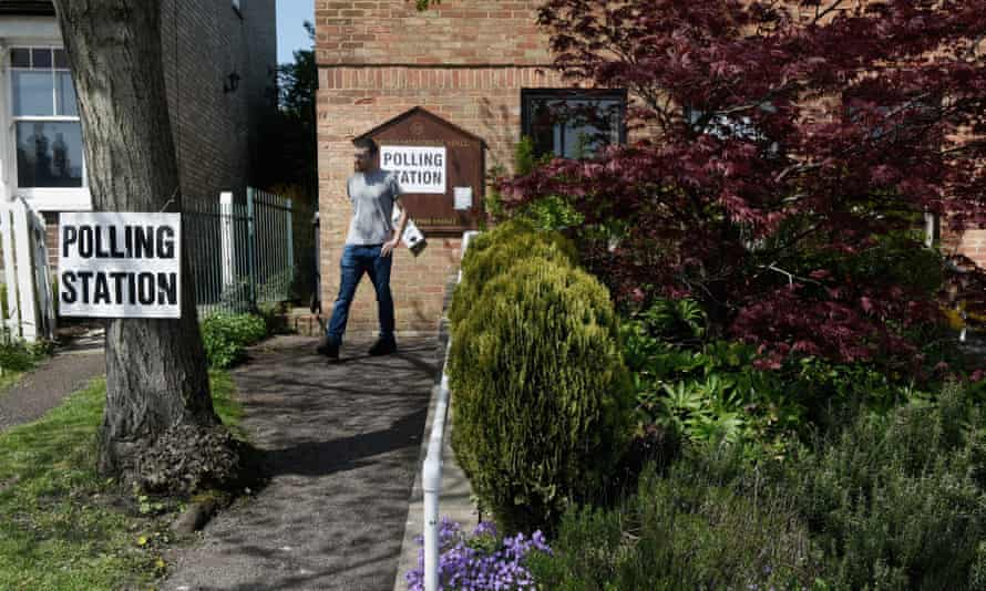 A man leaves a polling station in Chipping Barnet after being unable to vote because of a registration problem.