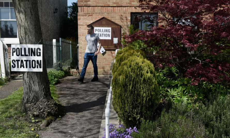 A young man leaves a polling station in Chipping Barnet, North London.