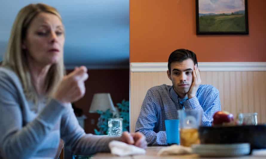 Kathleen Anduze's son Danny listens to her talk about her battle with Lewy Body Disease at their kitchen table in their Pleasant Valley, New York home.