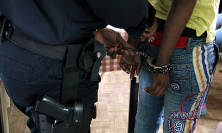 A man is arrested by a police officer