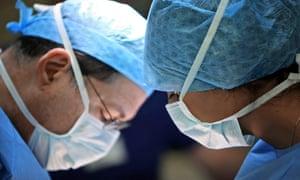Two masked surgeons