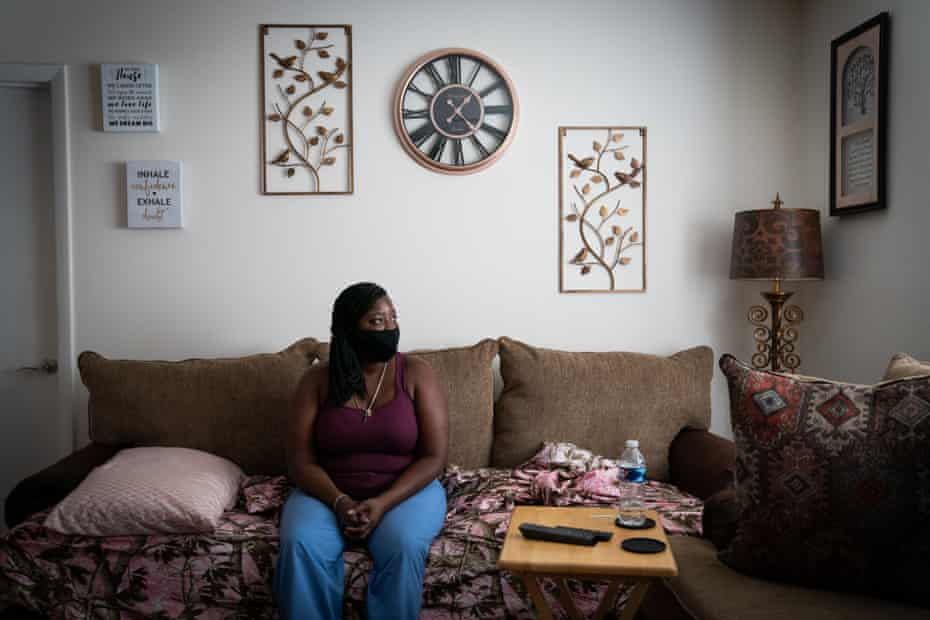 Florence Hobbs poses for a portrait on the couch on which she sleeps at her friend's home in West Ashley, Charleston.