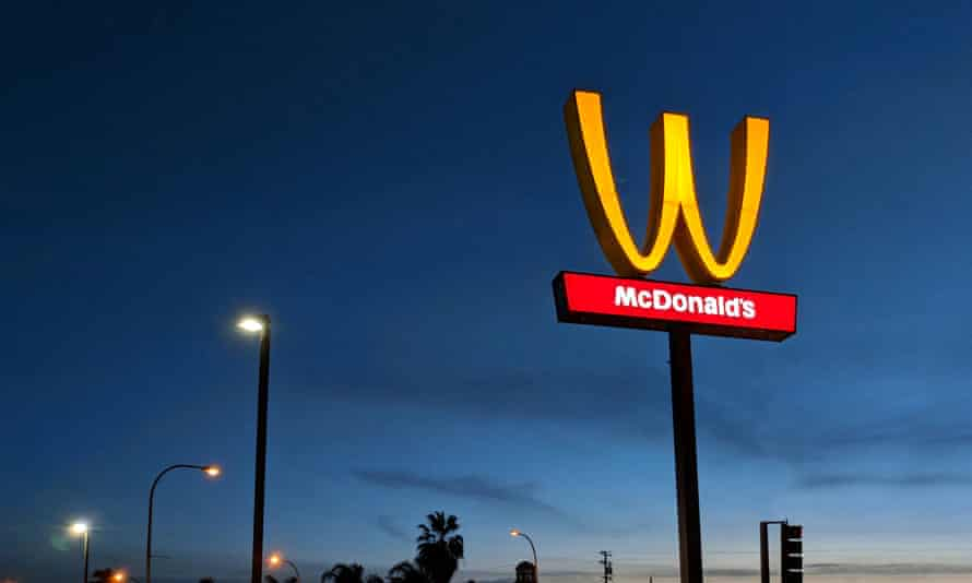 The McDonald's logo is turned upside down in honour of International Women's Day in Lynwood, California.