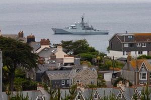 A navy ship patrols at St Ives
