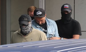 Kirill Serebrennikov (centre) outside the Russian Investigative Committee building.