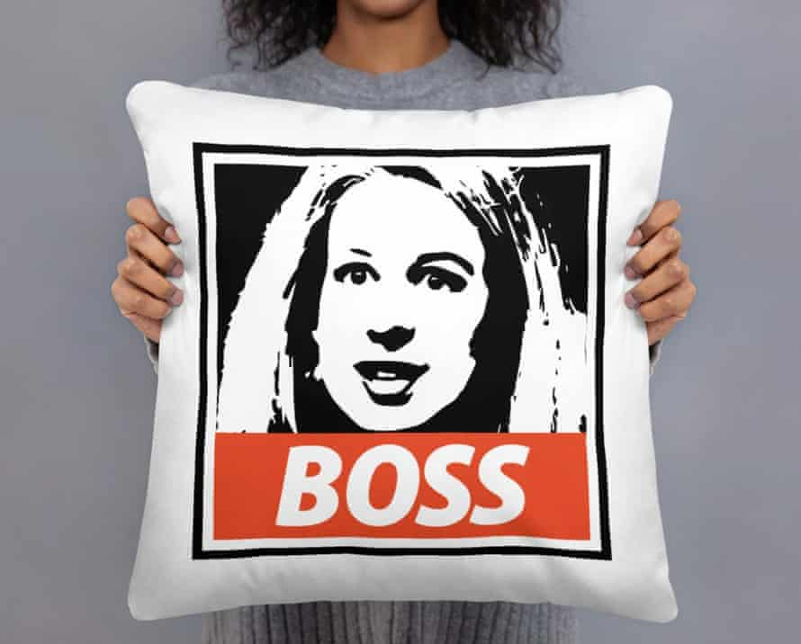 """A pillow with a picture of Elizabeth Holmes is emblazoned with """"Boss""""."""