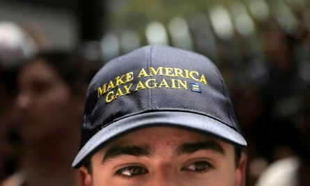 At the annual Pride Parade in San Francisco, a man wears a hat that parodies Donald Trump's campaign slogan.