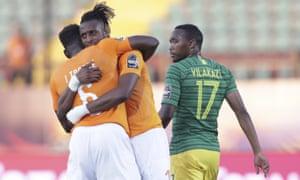 Goalscorer Jonathan Kodjia celebrates with Traoré at the final whistle.