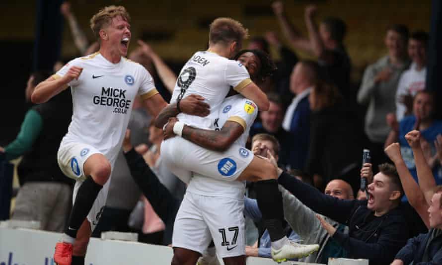 Peterborough's Ivan Toney gets a hug from Matt Godden after scoring against Southend.