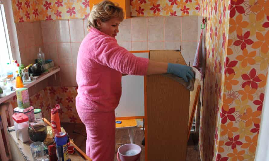 Nadezhda Scherbakova moves furniture out of her flat after thawing permafrost caused the structure to crack.