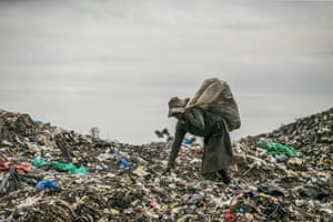 A woman walks on the Dandora rubbish dump. The landfill site is 8km east of the city centre. Every day, more than 2,000 metric tonnes of waste are dumped on this site. More than 3,000 pickers work day by day at the sprawling 30-acre rubbish dump.