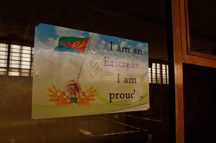 A patriotic poster set on a window in Asmara. Eritrea