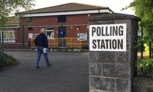 A Belfast voter arrives at a polling station. Photograph: David Young/PA Wire
