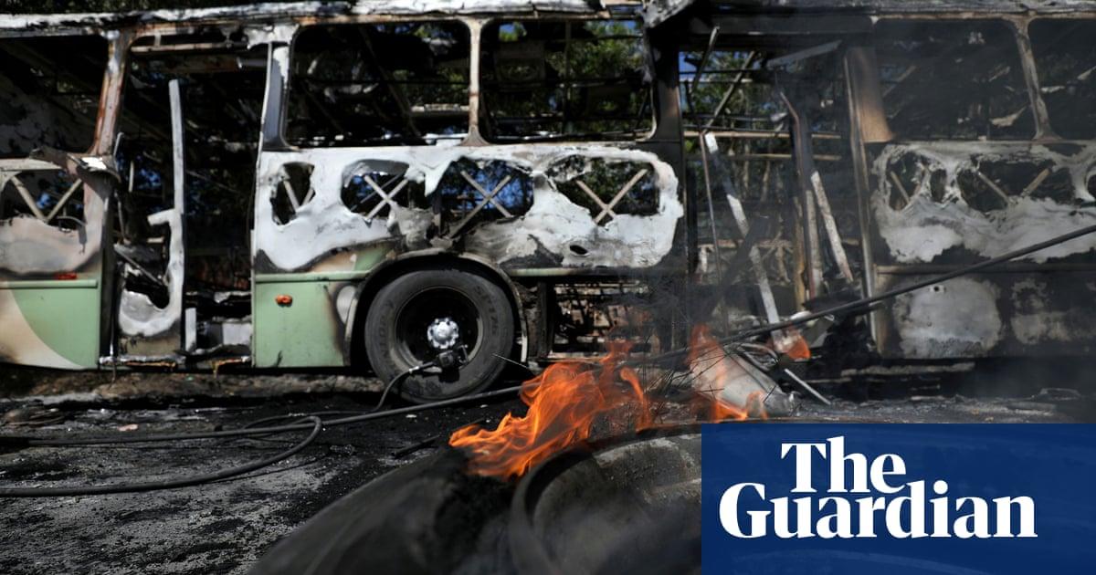 Brazilian city shuts schools and transport as drug gangs avenge leader's killing