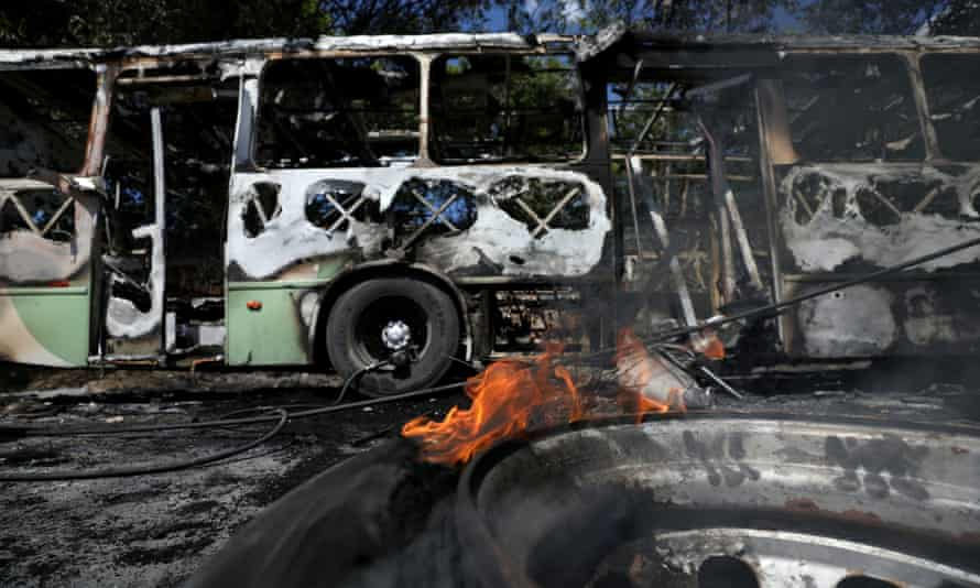 A burnt-out bus on the streets of Manaus in Brazil after the death of a drug trafficker sparked a backlash from gangs in the capital of Amazonas.