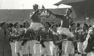 Stanley Matthews and captain Harry Johnston are carried on the shoulders of their teammates.