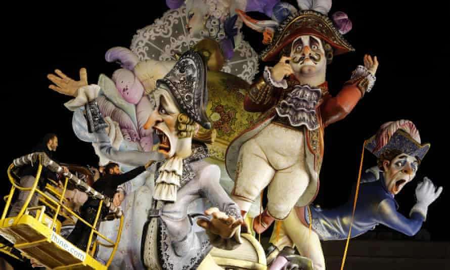 A worker puts finishing touches to a paper mache figure before the traditional Fallas festival in Valencia.