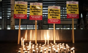 Signs and candles at a vigil for the 39 lorry victims, outside the Home Office in London