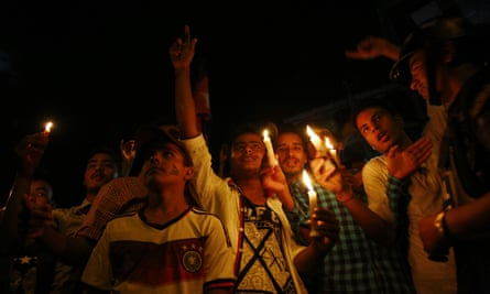 People light candles in Kathmandu to celebrate the adoption of  Nepal's new constitution.