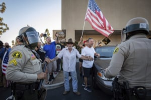 Yucaipa, US. Supporters of Donald Trump shout at counter-protesters as police escort them away from the scene in California. A clash erupted after Black Lives Matter protesters interrupted a pro-Trump demonstration