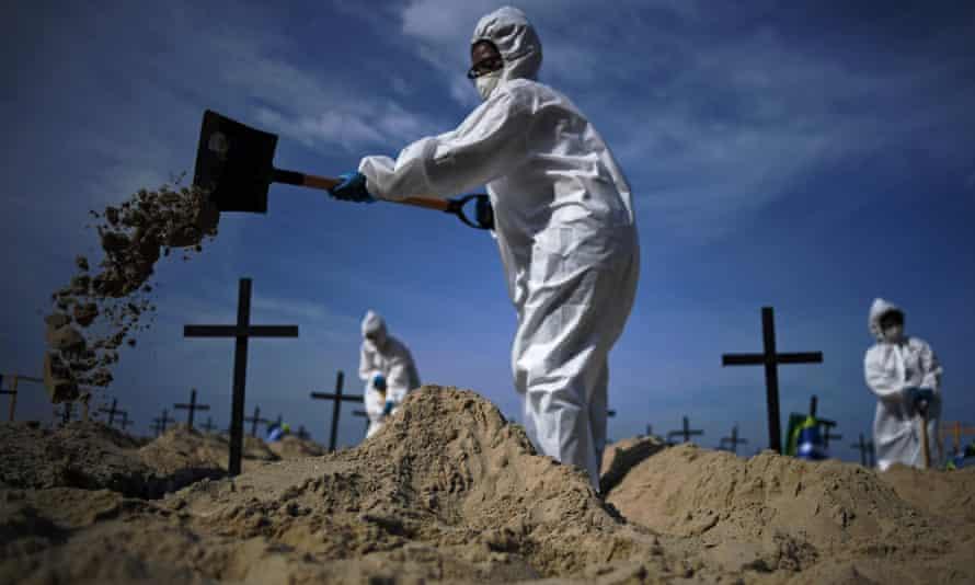 Activists dig 100 mock graves on Copacabana beach in Rio de Janeiro, Brazil on 11 June 2020.