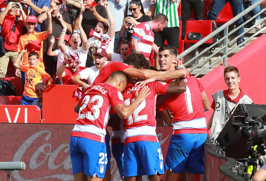 Granada players celebrate after scoring the only goal against Betis.