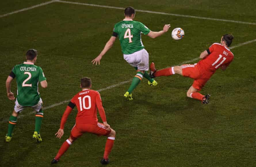 Gareth Bale flies in on John O'Shea.