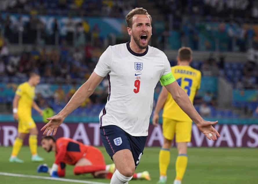 England's Harry Kane celebrates scoring their first goal