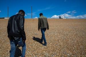 Two Sudanese asylum seekers on a beach on the Kent coast.