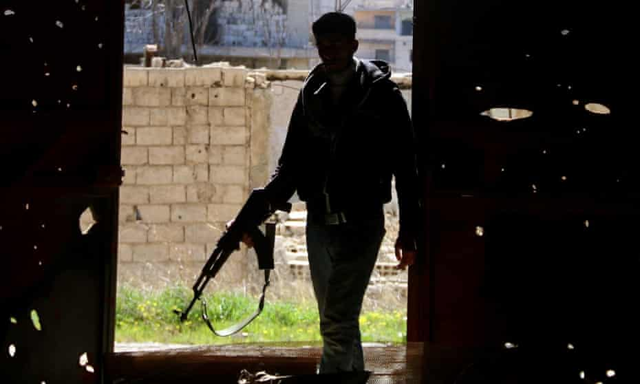 A member of the Free Syrian Army bearing a rifle