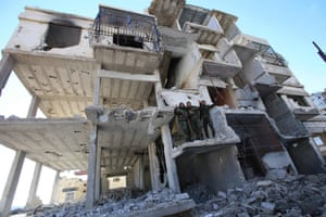 Syrian pro-government forces in a destroyed building in the strategic town of Salma after its recapture